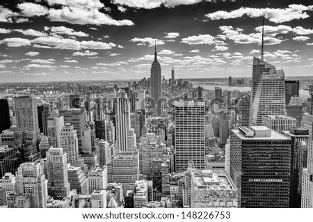 NEW YORK - CIRCA MAY 2013: The New York Skyline dominated by the Empire State Building, circa May 2013. The Empire S.B. is the main landmark and American cultural icon in New York - stock photo