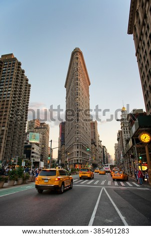 NEW YORK - CIRCA SEPTEMBER 2015: Traffic Passing Through Intersection on Fifth Avenue Outside of Historic Flatiron Building in Early Evening, Manhattan, New York City, New York, USA - stock photo