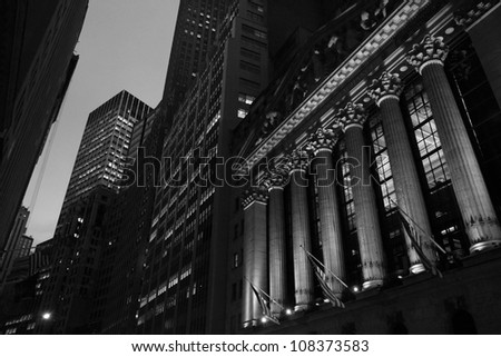 NEW YORK - CIRCA 2012: Sunset view of the New York Stock Exchange on Wall Street,  circa 2012 in New York City. - stock photo