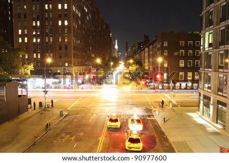 NEW YORK - CIRCA 2011 (TIME-LAPSE): Taxis wait at a red light in Manhattan in this timelapse view circa 2011 in New York City. - stock photo