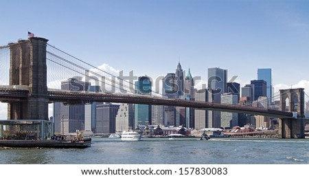 New York city and Brooklyn bridge at daytime - stock photo