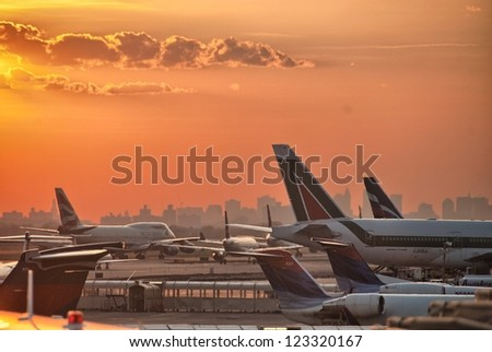 NEW YORK CITY - APR 27: Airplanes prepare for take off, April 27, 2010 in JFK airport, New York City. The airport serves almost 50 million passengers each year. - stock photo
