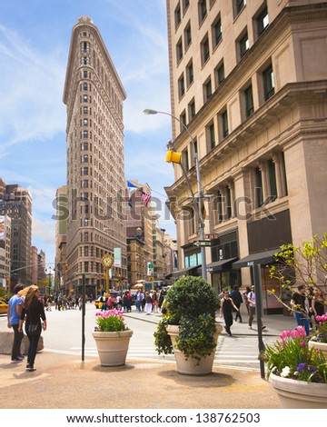 NEW YORK CITY - APR. 20: Historic Flatiron Building in NYC as seen on April 20, 2012. This iconic triangular building located in Manhattan's Fifth Ave was completed in 1902. - stock photo