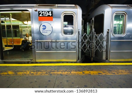 NEW YORK CITY - Apr 20, 2012: Subway car with passenger in NYC at  station on Apr 20, 2012.  NYC Subway is one of the oldest most extensive public transportation systems in the world with 468 stations - stock photo