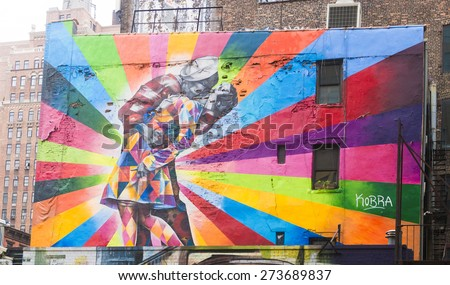NEW YORK CITY - APRIL 17: Mural art by brazilian artist Eduardo Kobra based on Alfred Eisenstaedt's photo from V-J Day in Times Square, on April 17, 2015 in New York City.  - stock photo