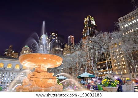 NEW YORK CITY - APRIL 9: people enjoy Bryant Park at night April 9, 2013 in New York, NY. The 9.6 acre park was first designated as public space in 1686. - stock photo