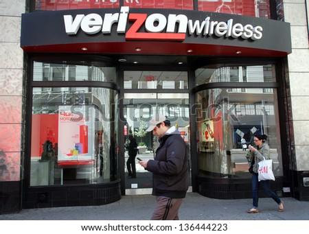 NEW YORK CITY - APRIL 19: People walk past a Verizon Wireless retail outlet in New York City, on Friday, April 19, 2013. - stock photo