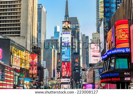 NEW YORK CITY - APRIL 5: Times Square ,is a busy tourist intersection of neon art and commerce and is an iconic street of New York City and America, April 5, 2014 in Manhattan, New York City. - stock photo