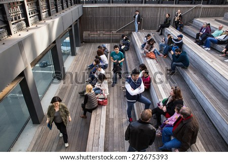NEW YORK CITY - APRIL 6, 2015:    View of the 10th Avenue Square Overlook on The High Line park with visitors relaxing and mingling. - stock photo