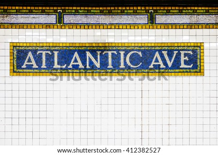New York City Atlantic Avenue subway station with mosaic plate sign. New York City, USA name tile pattern in subway station, Manhattan metropolitan, NYC. - stock photo