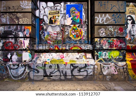 NEW YORK CITY - AUG 30: Graffiti now covers this landmark building at 190 Bowery in New York City on Aug. 30, 2012.  This historic building is the Former The Germania Bank Building from the 1890's. - stock photo