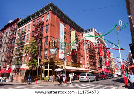 NEW YORK CITY - AUG 30:  Intersection in historic Little Italy in lower Manhattan on Aug. 30, 2012.  This landmark Italian neighborhood is known for its restaurants and annual Feast of San Genarro. - stock photo