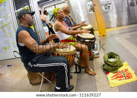 NEW YORK CITY - AUG 29:  Music Under New York African hand-drummers perform in Penn Station, NYC on Aug. 20, 2012.  MUNY has been presenting music to commuters of NYC public transit since 1985. - stock photo