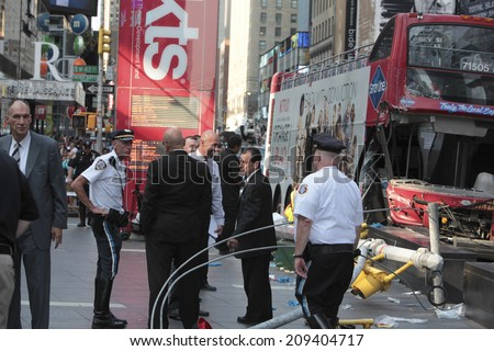 NEW YORK CITY - AUGUST 5 2014: a Gray Line double-decker tour bus collided with another tour bus in Times Square before smashing into a light pole on Duffy Square. 15 were injured; 3 seriously. - stock photo