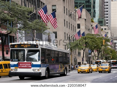 NEW YORK CITY - AUGUST 3: A view of 5th avenue on August 3, 2014.  5th Ave is lined with prestigious shops and is consistently ranked among the most expensive shopping streets in the world. - stock photo