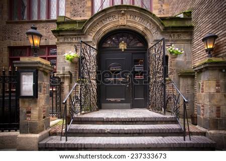 NEW YORK CITY - AUGUST 3, 2014:  Dubliner Irish pub on historic Stone Street in Manhattan's Financial District.  - stock photo
