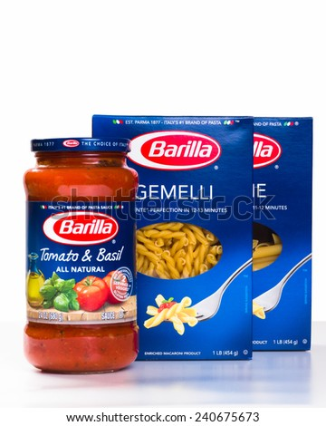 NEW YORK CITY - AUGUST 13, 2014: Family of Barilla Italian products including tomato sauce and pastas against white background.  - stock photo