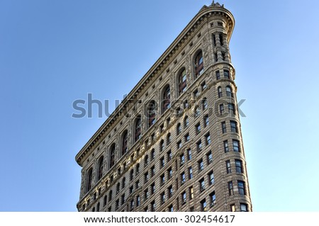 New York City - August 1, 2015: Flat Iron building facade. Completed in 1902, it is considered to be one of the first skyscrapers ever built. - stock photo