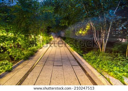 NEW YORK CITY - AUGUST 9, 2014:  Night scene along The High Line Park in Manhattan.  - stock photo