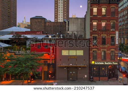 NEW YORK CITY - AUGUST 9, 2014:  Night scene the Chelsea section in Manhattan seen from The High Line.  - stock photo