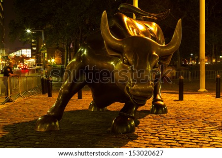 NEW YORK CITY - AUGUST  10: The landmark Charging Bull in Lower Manhattan represents aggressive financial optimism and prosperity August 10, 2013 in New York, NY.  - stock photo