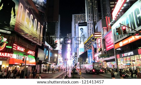 NEW YORK CITY - AUGUST 16: Times Square, featured with Broadway Theaters and animated LED signs, is a symbol of New York and the United States, August 16, 2012 in Manhattan - stock photo