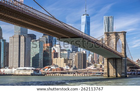 New York City Brooklyn Bridge downtown buildings skyline - stock photo