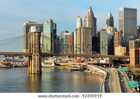 New York City, Brooklyn Bridge in sunrise with Lower Manhattan background - stock photo
