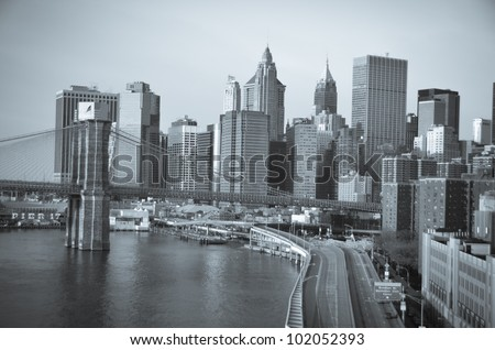 New York City, Brooklyn Bridge in sunrise with Lower Manhattan background - Split toned - stock photo