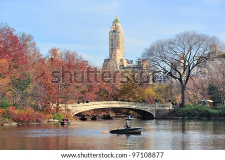 New York City Central Park in Autumn in midtown Manhattan with colorful foliage and boat in lake - stock photo