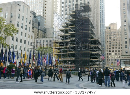 NEW YORK CITY, CIRCA NOVEMBER 2015. Tourists crowd around the new Christmas Tree in Rockefeller center which is being prepared for the 2015 holiday season. - stock photo