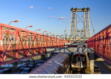 NEW YORK CITY - CIRCA 2015: Subway cars cross the Williamsburg Bridge during rush hour in New York City. The bridge connects the Lower East Side of Manhattan with Williamsburg in Brooklyn, - stock photo
