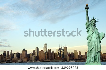 new york city cityscape skyline with statue of liberty - stock photo