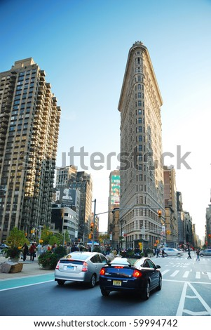 NEW YORK CITY - DEC 7: Flat Iron building, considered to be one of the first skyscrapers ever built, with New York City street view. December 7, 2009 in Manhattan, New York City. - stock photo