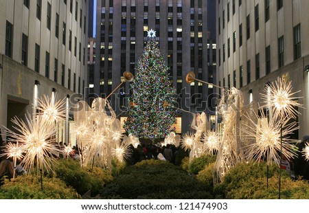 NEW YORK CITY - DEC. 8, 2012: New York City landmark, The famous Rockefeller Center Christmas tree viewed from the Channel Gardens, Dec. 8, 2012, celebrating the 80th anniversary of the tradition. - stock photo