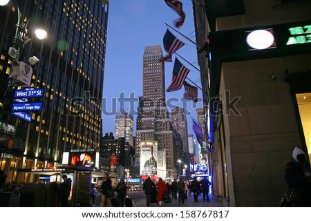 NEW YORK CITY - DEC 31: Nighttime in NY features with Madison Square Garden  is a symbol of New York City on December 31, 2008 in Manhattan, New York City - stock photo