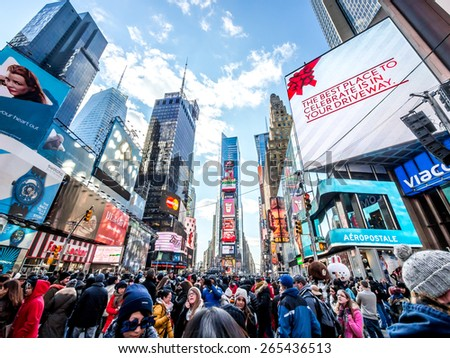 New York City - 31 dec 2014: People walking in times square waiting to celebrate new year in Manhattan. - stock photo