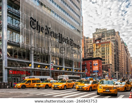 NEW YORK CITY - DEC 01 The New York Times building and characteristic Yellow Taxi Cab,on December 01th, 2013 in Manhattan, New York City. USA. - stock photo