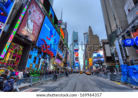 NEW YORK CITY - DEC 30: Times Square ,is a busy tourist intersection of neon art and commerce and is an iconic street of New York City and America, December 30, 2013 in Manhattan, New York City - stock photo
