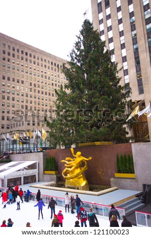 NEW YORK CITY - DEC 2: Visitors at Rockefeller Center in NYC on Dec 2, 2012. Declared a National Historic Landmark Rockefeller Ctr. is home to the iconic NYC Christmas Tree and ice skating rink. - stock photo