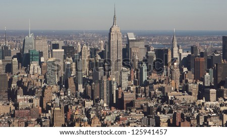 NEW YORK CITY - DECEMBER 24: Aerial view of Manhattan New York City on December 24, 2010.Manhattan is the most densely populated and the oldest of the five boroughs of New York City. - stock photo
