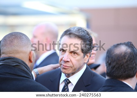 NEW YORK CITY - DECEMBER 27 2014: along with political leaders, uniformed police officers from all over north America attended funeral services for NYPD officer Rafael Ramos. NY Governor Andrew Cuomo - stock photo