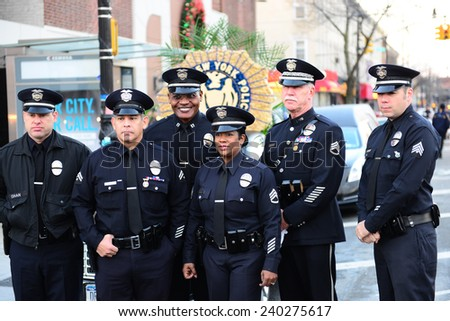 NEW YORK CITY - DECEMBER 27 2014: along with political leaders, uniformed police officers from all over north America attended funeral services for slain NYPD officer Rafael Ramos. LAPD officers - stock photo