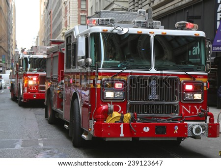 NEW YORK CITY- DECEMBER 18: FDNY Engine 1 in midtown Manhattan on December 18, 2014. FDNY is the largest combined Fire and EMS provider in the world - stock photo