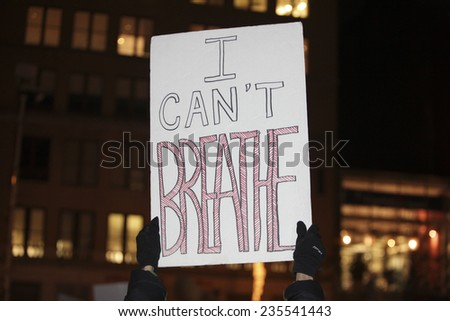 NEW YORK CITY - DECEMBER 4 2014:for the second night thousands of protesters filled the streets of Manhattan to march against a Staten Island grand jury's failure to indict in the death of Eric Garner - stock photo