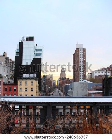 NEW YORK CITY - DECEMBER 25: New York Cityscape seen from High Line Park on December 25, 2013. The High Line is a public park built on an historic freight rail line elevated above the streets. - stock photo