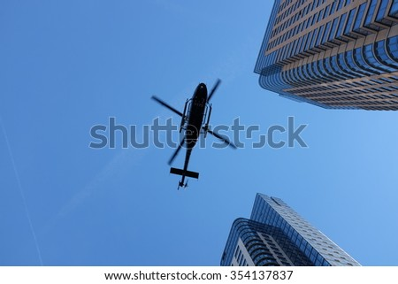 NEW YORK CITY - DECEMBER 20 2015: NYC mayor de Blasio joined the families of slain officers Wenjian Liu & Rafael Ramos to dedicate a plaque at the 84th precinct. NYPD helicopter flies over precinct - stock photo