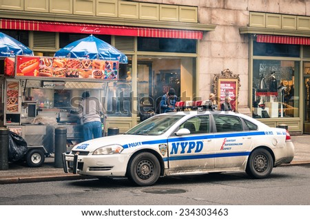 NEW YORK CITY - 22 DECEMBER, 2013: NYPD car parked at Grand Central Station in Manhattan downtown; established in 1845, NYPD is the largest municipal police force in the United States. - stock photo