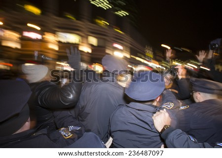 "NEW YORK CITY - DECEMBER 8 2014: several hundred activists staged a ""shut it down"" rally at Barclays Center protesting police brutality that coincided with a visit by the Duke & Duchess of Cambridge - stock photo"