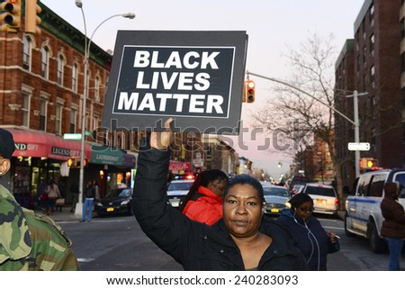 NEW YORK CITY - DECEMBER 27 2014: several protesters gathered at the Pink Houses for a march to Police Services Area #2 station demanding justice for Akai Gurley, who was killed by Peter Liang  - stock photo